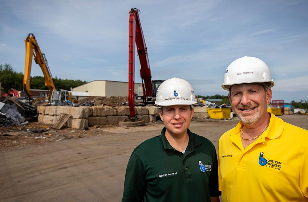 Jason and Paul Brenner in the yard of their Hazleton, PA, recycling facility.